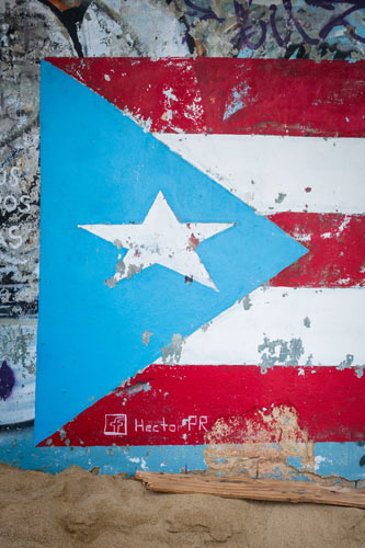 graffiti of the puerto rican national flag tagged by the artist