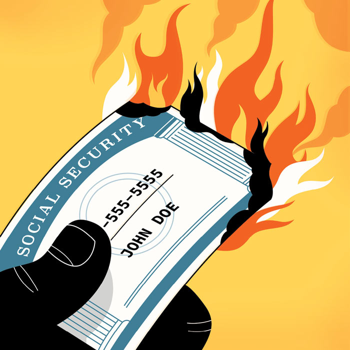 illustration of a hand holding a burning social security card