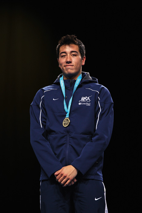 Gerek Meinhardt wearing a gold olympic medal