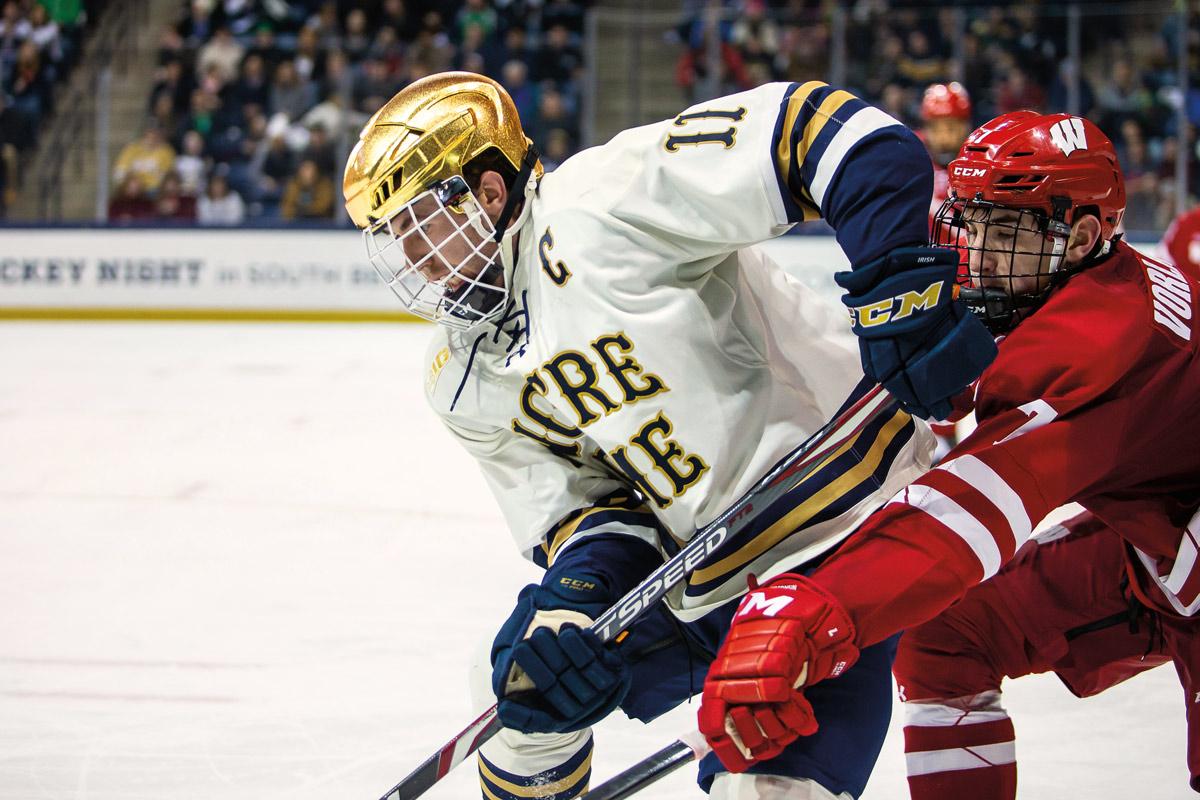 Cal Burke playing hockey