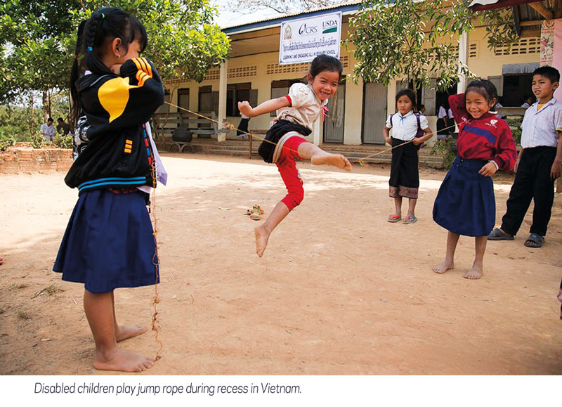 disabled children play jump rope in Vietnam